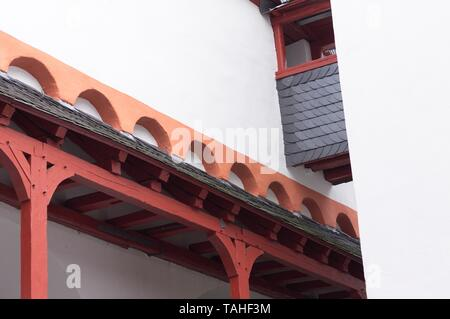 Red wooden columns of a white medieval building (Germany, Europe) - Stock Photo