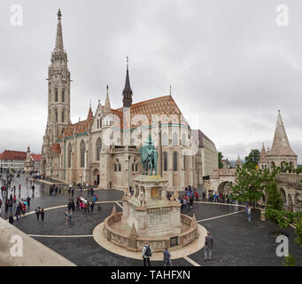 St Stephen's Statue Matthias Church or the Church of Our Lady roof covered with majolica Zsolnay ceramic tiles Buda castle district Budapest Hungary - Stock Photo
