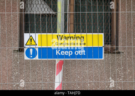Health and Safety warning sign on building construction site fence. Metaphor Health and Safety at work, Keep Out warning sign, building site fence. - Stock Photo