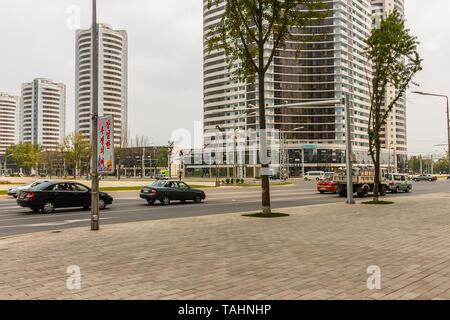Pyongyang, North Korea - July 29, 2014: Mansudae Street in Pyongyang. Crossroads Mansudae street and Sungri street. - Stock Photo