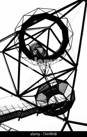 Black and white photography of the Tetrahedron in Bottrop, Germany taken from below against the sky. The incredible steel construction serves as a view point. It was built on a mine dump. - Stock Photo