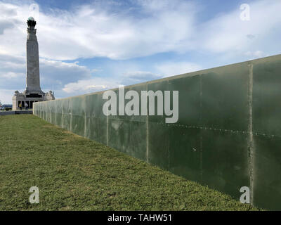 Security fencing put up next to Portsmouth Naval Memorial on Southsea Common ahead of visit by US President Donald Trump for the 75th anniversary of D-Day. - Stock Photo