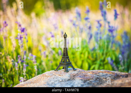 Miniature Eiffel tower in Lavender field . monument figurine - Stock Photo