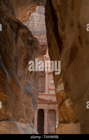 Jordan, Petra (UNESCO)  View of The Treasury from The Siq. 1.2 km long natural  gorge and entry into ancient Nabataean kingdom. - Stock Photo