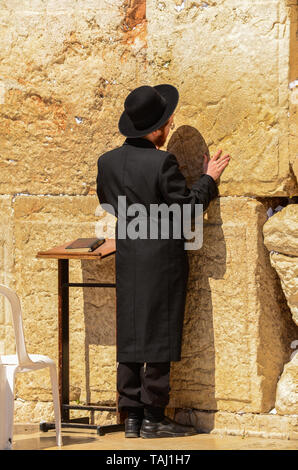 Jerusalem/Israel- July 11, 2014: Orthodox Jewish man praying at the Western Wall in Jerusalem, Israel - Stock Photo