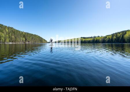 Being playful between kayaking at Kolovesi national park, Enonkoski, Finland - Stock Photo