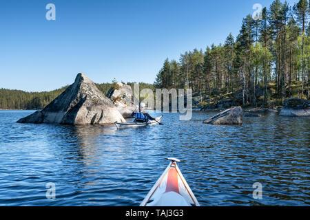 Kayaking at Kolovesi national park, Enonkoski, Finland - Stock Photo