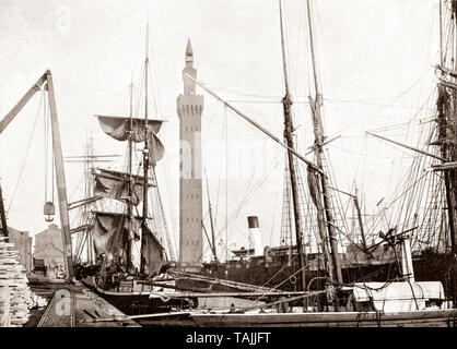 A late 19th Century view of  the Hydraulic Dock Tower  behind shipping in Grimsby, also Great Grimsby, a large coastal English seaport and administrative centre in North East Lincolnshire, on the South Bank of the Humber Estuary, close to where it reaches the North Sea. Many docks were completed in the mid-19th century with the arrival of the railway in 1848, after which it boasted the largest fishing fleet in the world by the mid-20th century, until fishing declined. - Stock Photo
