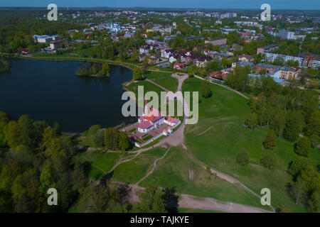 Priory Palace in the cityscape on a sunny May day (aerial photography). Gatchina, Russia - Stock Photo