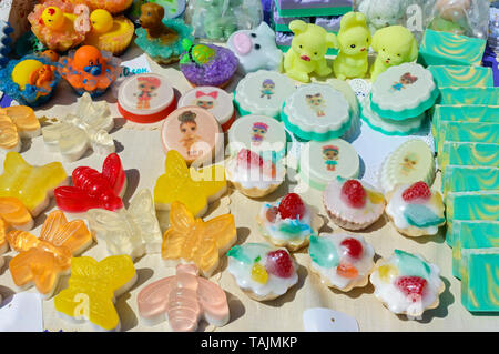 Beautiful colorful handmade soap. Soap manufacture Eco goods. Fair - an exhibition of folk craftsmen. - Stock Photo