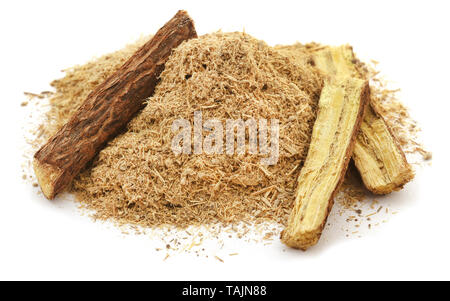 Liquorice stick and ground powder over white background - Stock Photo
