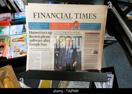 'Huawei tees up its own phone software after Google ban' Financial Times newspaper headlines front page '' and after milkshake incident 'Spilt Milk - Nigel Farage decries 'stitch up'  over scrutiny of Brexit party funding'  in FT newspaper headline on a supermarket newsstand shelf on 21 May 2019 in London England UK - Stock Photo