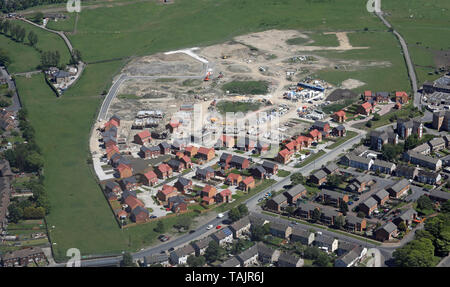 aerial view of new houses being built on a green field site in Northern England - Stock Photo