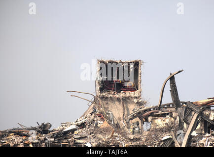 Factory structure exposed during demolition - Stock Photo