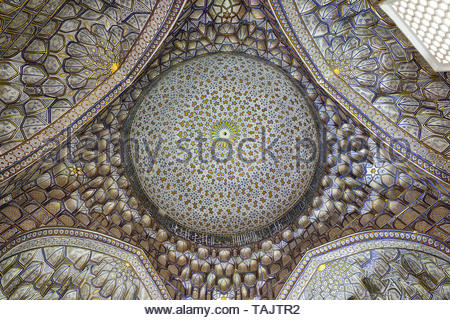 SHAKHI ZINDA, SAMARKAND, UZBEKISTAN - 22 APRIL 2019: Nice decorated inside of the tomb in historical necropolis was formed over eight (from 11th till  - Stock Photo