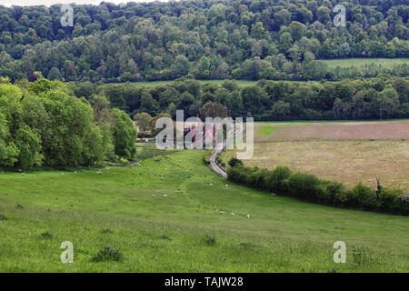 An English Rural Landscape in the Chiltern Hills with farmhouse in the valley - Stock Photo