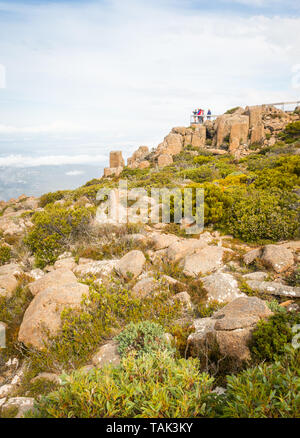 TASMANIA, AUSTRALIA - FEBRUARY 16, 2019: Tourists on a viewing platform on top of Mount Wellington, looking at Hobart, the capital city of Tasmania in - Stock Photo