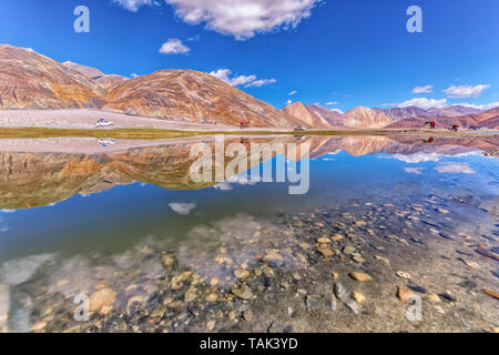Reflections on Pangong Tso, also known as Pangong Lake, located in the Himalayas and situated at a height of about 14,270 ft. Tibetan for 'high grassland lake'. - Stock Photo