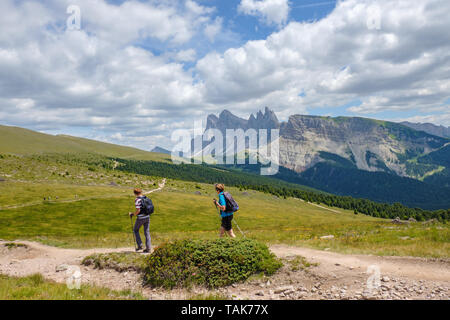 Women on a hiking trail in the Alps - Stock Photo