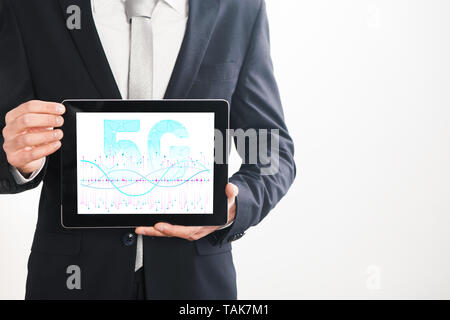 5g tablet on businessman hand connect worldwide. 5G network connection concept. - Stock Photo