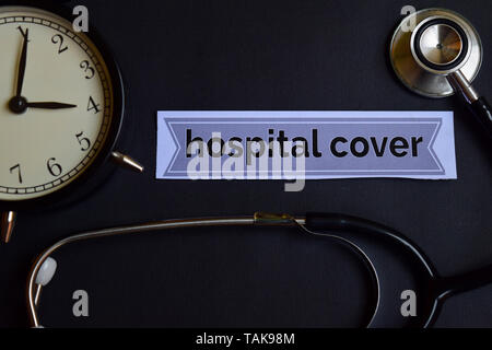 Hospital Cover on the print paper with Healthcare Concept Inspiration. alarm clock, Black stethoscope. - Stock Photo