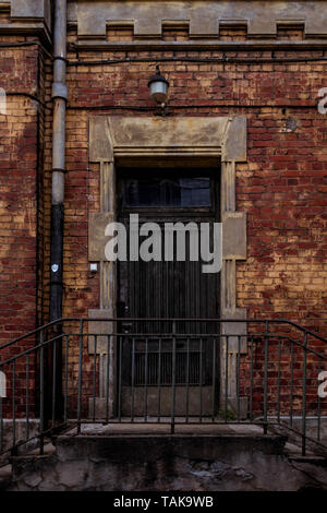Wooden doors of old, abandoned power plant in Riga, Andrejsala. - Stock Photo