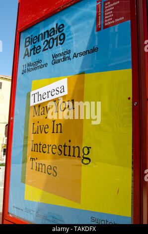 VENICE, ITALY - MAY 16, 2019: Sign promoting the Venice Biennale with a sticker referring to the British Prime Minister Theresa May. - Stock Photo