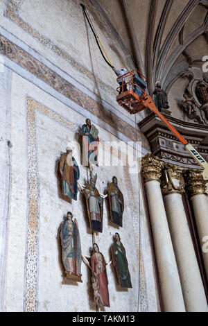 Workers restore the interior of the San Nicolas Tolentino Temple and Ex-Monastery in Actopan, Hidalgo, Mexico. The colonial church and convent  was built in 1546 and combine architectural elements from the romantic, gothic and renaissance periods. - Stock Photo