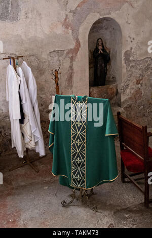 Priests vestments in the San Nicolas Tolentino Temple and Ex-Monastery in Actopan, Hidalgo, Mexico. The colonial church and convent  was built in 1546 and combine architectural elements from the romantic, gothic and renaissance periods. - Stock Photo