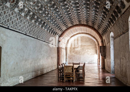 Friars dining room in the San Nicolas Tolentino Temple and Ex-Monastery in Actopan, Hidalgo, Mexico. The colonial church and convent  was built in 1546 and combine architectural elements from the romantic, gothic and renaissance periods. - Stock Photo