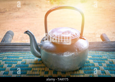 Vintage kettle stainless steel of kettle boil water for hot water tea and coffee - Ancient old retro boiler pot - Stock Photo