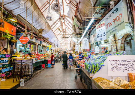Jerusalem, Israel- August 16, 2016: An orthodox Jewish man and a young boy shopping for nuts in the Mahane Yehudah market in Jerusalem, Israel - Stock Photo