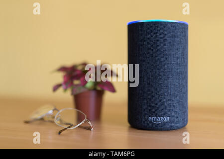 The 2017 release of a charcoal Amazon Echo (2nd generation) smart speaker and personal assistant Alexa shot in a home environment. - Stock Photo