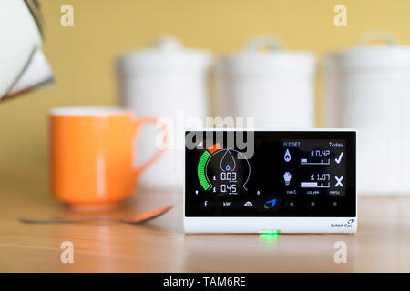 A domestic use British Gas energy smart meter displaying the cost of gas electricity usage in a UK home, placed in a kitchen environment. - Stock Photo