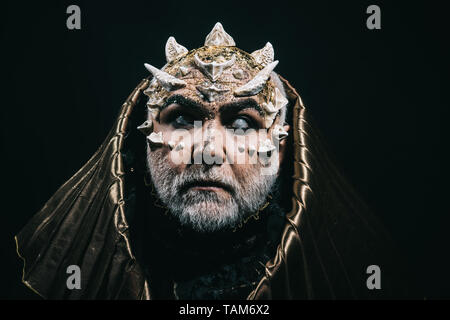 Blind ancient monster with thorns on face, myth and legends concept. Old guardian of nature, forest deity with white beard and horns on black - Stock Photo