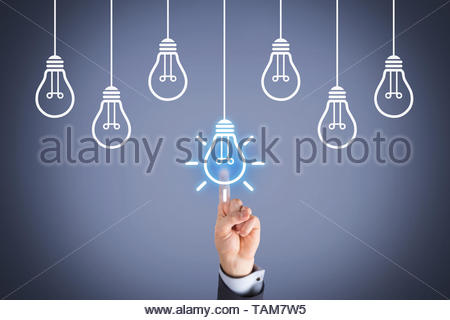 Idea Concepts with Light Bulb on Screen - Stock Photo