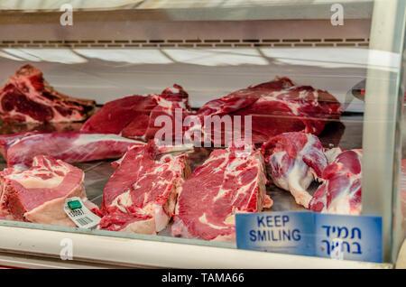 Raw meat for sale in the Mahane Yehudah market in Jerusalem, Israel - Stock Photo