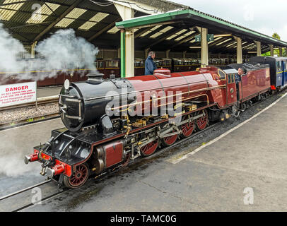 Light 4-8-2 steam engine Hercules on train at Romney, Hythe and Dymchurch light Railway station at New Romney Kent England UK - Stock Photo