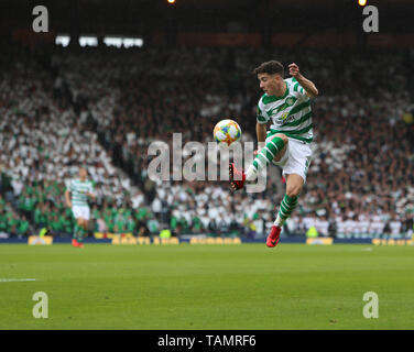 25th May 2019, Hampden Park, Glasgow, Scotland; Scottish Football Cup Final, Heart of Midlothian versus Celtic; Mikey Johnston of Celtic leaps to bring the high ball under control - Stock Photo