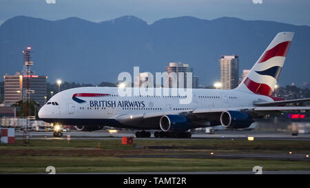 May 19, 2019 - Richmond, British Columbia, Canada - A British Airways Airbus A380-841 (G-XLEL) jetliner takes off at dusk from Vancouver International Airport. (Credit Image: © Bayne Stanley/ZUMA Wire) - Stock Photo