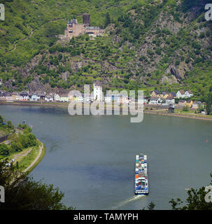 Container ship at St. Goarshausen, above the Katz castle, Unesco world heritage site, Upper Middle Rhine Valley, Rhineland-Palatinate, Germany - Stock Photo