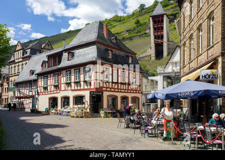Street cafe and old half-timbered houses at Bacharach, Unesco world heritage site, Upper Middle Rhine Valley, Rhineland-Palatinate, Germany - Stock Photo