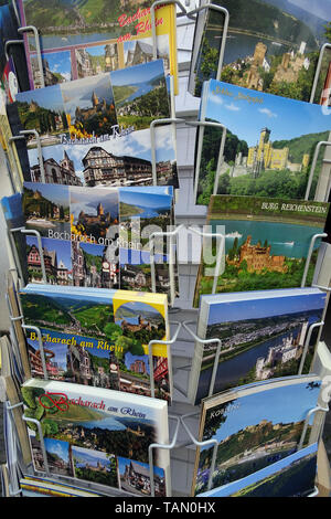 Picture postcard rack in front of a souvenir shop, Bacharach, Unesco world heritage site, Upper Middle Rhine Valley, Rhineland-Palatinate, Germany - Stock Photo