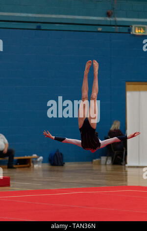 Various gymnasts competing for the NDP qualification in British Gymnastics at Fenton Manor, Stoke on Trent in May 2019. No faces visible, editorial usage only - Stock Photo