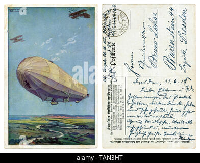 German historical postcard: The German air fleet, a huge Zeppelin airship with two military airplanes flying in the air on the background fields, wwi - Stock Photo