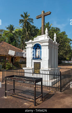 White chapel in front of Basilica of Bom Jesus, Old Goa, India - Stock Photo