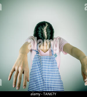 Zombie overworked housewife is so tired she is dying - Stock Photo