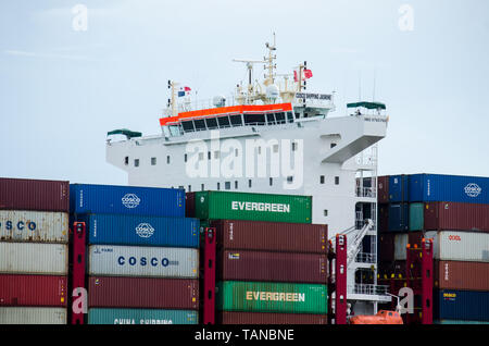 Details of Cosco Shipping Jasmine taken while it went transiting the Panama Canal at the Culebra Cut entrance from the Gatun Lake to Pacific Ocean - Stock Photo