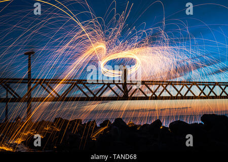 Steel wool photography, spectacular and cool photography with burning steel wool - Stock Photo
