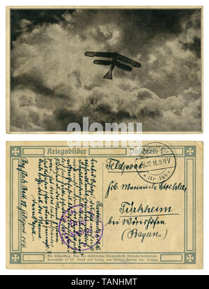 German historical postcard: 'A high-altitude flight' Silhouette of a biplane against a background of clouds.  Back side, Flak postmark, wwi - Stock Photo